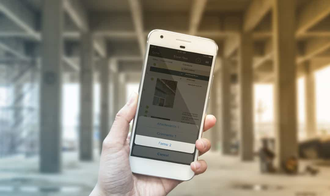 The Smartsheet mobile app viewed via iPhone at a construction site